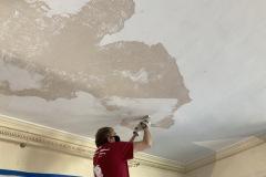 Ceiling plaster scraping