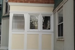 Restored glass beside entry